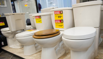 Row of toilets on display in a store