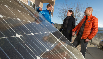 a couple talking to an energy advisor about solar panels