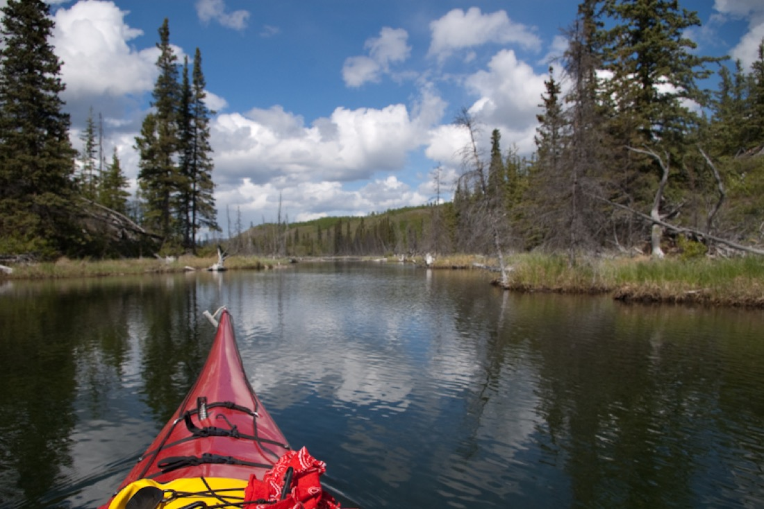 Sea kayaking the beaver ponds at Snafu Lake Campground, Yukon.