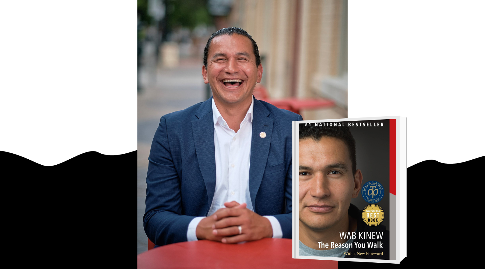 Author Wab Kinew sits at a table with a wide smile. The cover of the book is pictured.