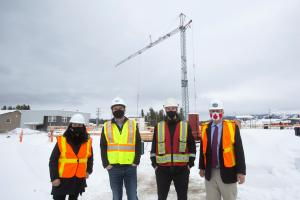 Right to left: Minister Pauline Frost, Michael Hale, President and Chief Operating Officer of Northern Vision Development LP, Joe Densmore is Project Manager with Ketza Construction Corporation and Larry Bagnell, Member of Parliament for Yukon.