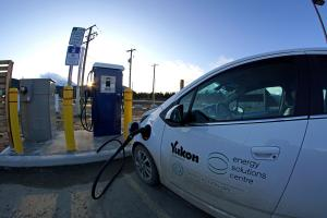 Government of Yukon's electric fleet vehicle SPARKY making use of the first fast charger in Carcross.
