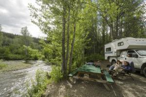 Campsite by the creek, Tatchun Creek Campground, Yukon.