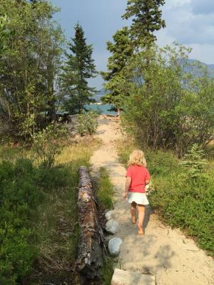 Kids walking on sandy trail to the lake