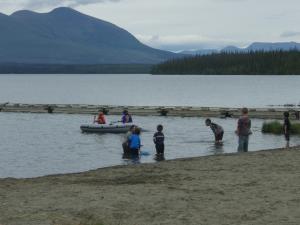 Children swimming at Pine Lake beach, Yukon