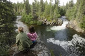 Kids overlooking Rancheria Falls, Yukon.