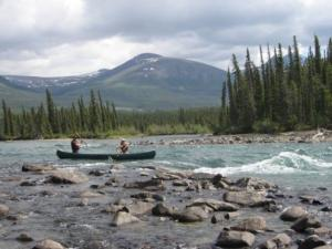Canoeing the rapids on the Takhini River, Yukon.