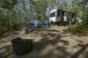 Peaceful campsite in aspen forest overlooking the lake, Teslin Lake Campground, Yukon