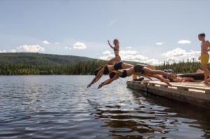 Diving off the dock at Tatchun Lake Campground, Yukon.