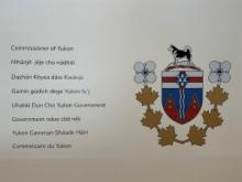 Commissioner unveils wall of translations