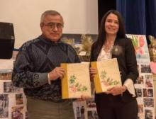 First Nation of Na-Cho Nyäk Dun Chief Simon Mervyn and Minister of Tourism and Culture Jeanie Dendys at the signing of the management plan.