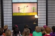 Children enjoy the Trouble puppet show