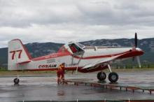 An Air Tractor AT-802 refueling on the runway at Erik Nielsen Whitehorse International Airport.