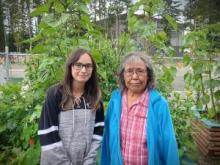Yukon's 2021 Council of the Federation Literacy Award winner, Champagne and Aishihik First Nations Elder Vera Brown (pictured, right) works alongside her granddaughter Nikki-Lee (pictured, left)